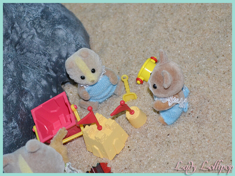 Sylvanian Families babies playing on the beach sand in the diorama